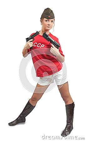 Beautiful girl in overseas cap holding guns