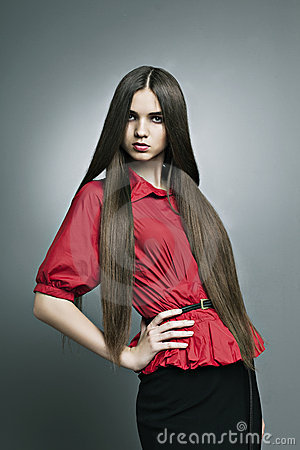 Beautiful girl with perfect skin and long hair
