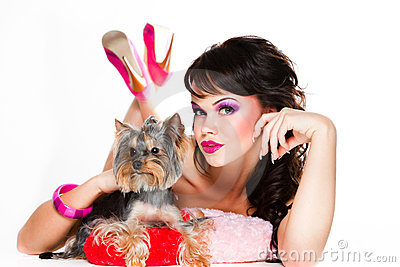 Beautiful girl in pink with yorkshire terrier
