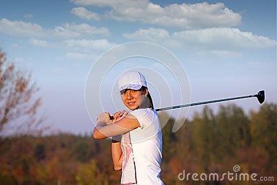 Beautiful girl play golf