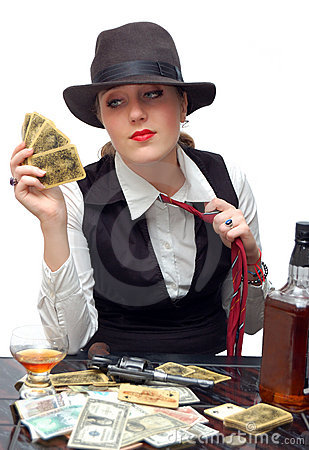 Beautiful girl with playing cards and gun
