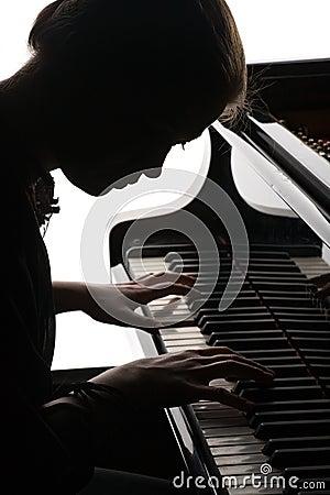 Beautiful girl playing the piano