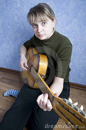 Beautiful girl plays on guitar