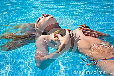 The beautiful girl in pool
