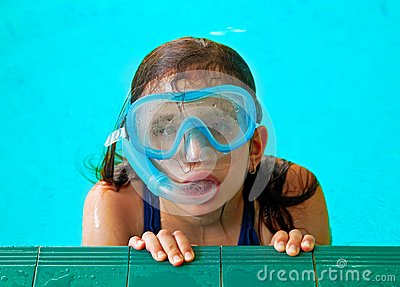 Beautiful girl in a pool with a swimming mask