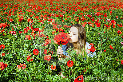 Beautiful  girl in a poppies field