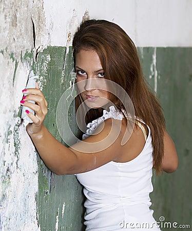 Beautiful girl portrait near a ruin wall