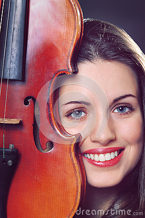 Beautiful girl portrait with a fiddle