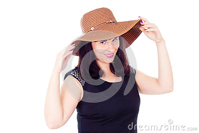 Beautiful girl poses in the hat