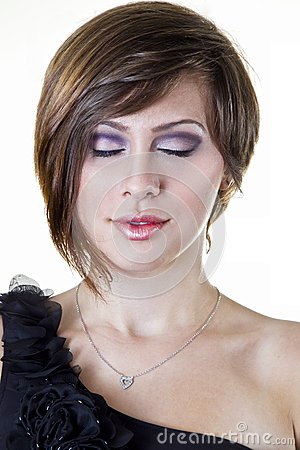 A beautiful girl poses with purple makeup