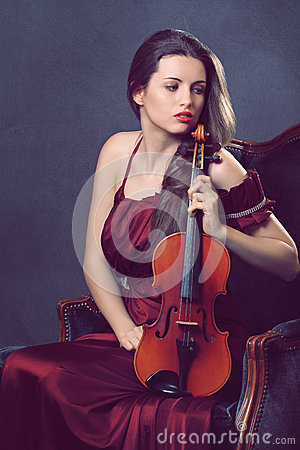 Beautiful girl posing with a fiddle
