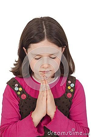 Beautiful girl praying with closed eyes