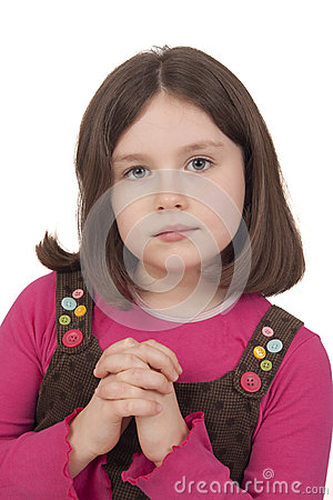 Beautiful girl praying with open eyes