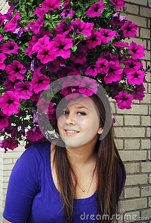 Beautiful girl in pretty hat from flowers