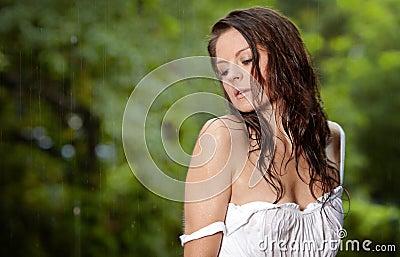 Beautiful girl in the rain