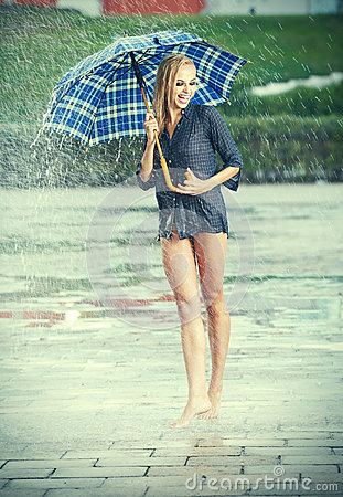 Beautiful girl in rain.