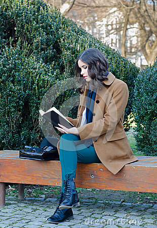 Free Beautiful Girl Reading Book In The Park In Spring Stock Images - 53281914