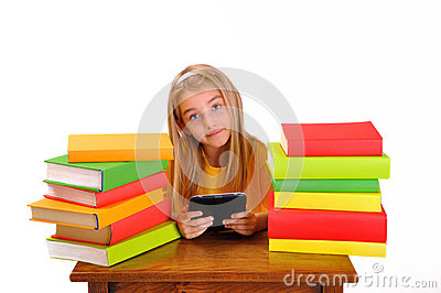 Beautiful girl reading e-book surrounded by books
