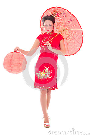 Beautiful girl in red japanese dress with umbrella and lantern i
