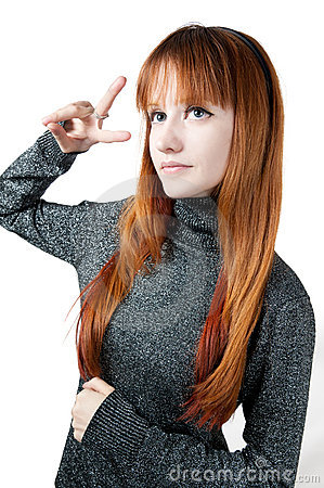 The beautiful girl with red long hair in a sweater