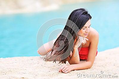 Beautiful girl relaxing on a beach