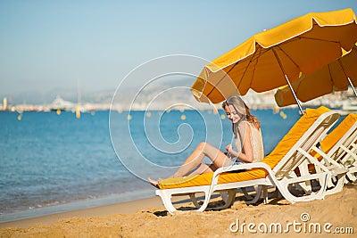 Beautiful girl relaxing on a beach chair