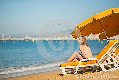 Beautiful girl relaxing on a beach chair