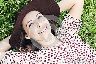 Beautiful girl relaxing in the grass