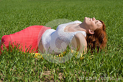 Beautiful girl rests in the meadow