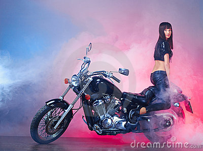 Beautiful girl on a retro motorcycle