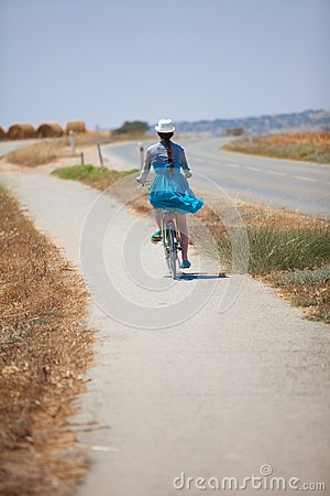 Beautiful girl riding bicycle