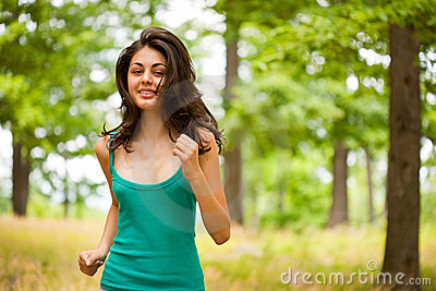 Beautiful girl running through forest