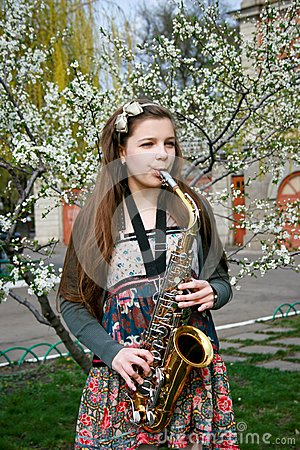 Beautiful girl with saxophone