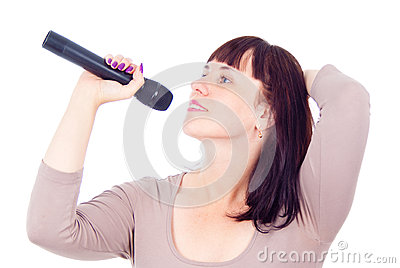 Beautiful girl singing into the microphone