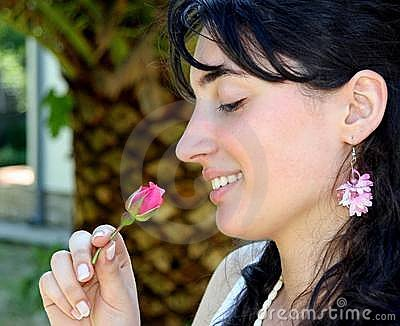 Beautiful girl smelling the rose