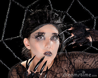 Beautiful girl with spider makeup