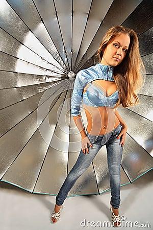 Beautiful girl stand near parabolic umbrella