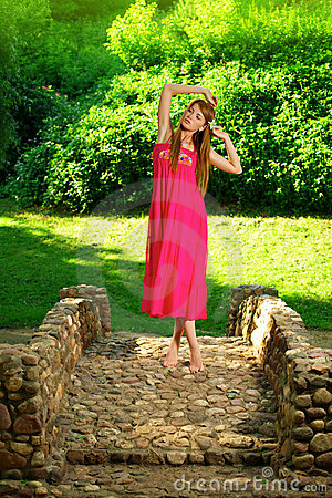 Beautiful girl standing on the rock bridge