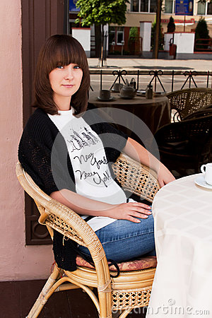 Beautiful girl in a summer cafe