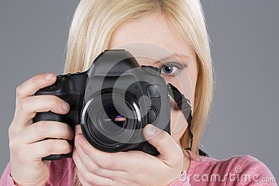 Beautiful girl takes photo with DSLR