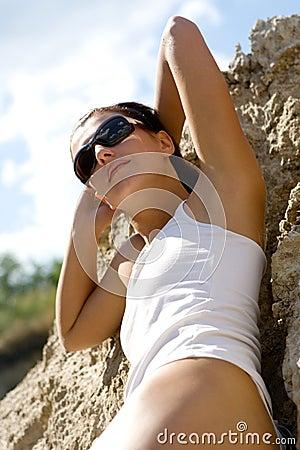Beautiful girl taking a sunbath