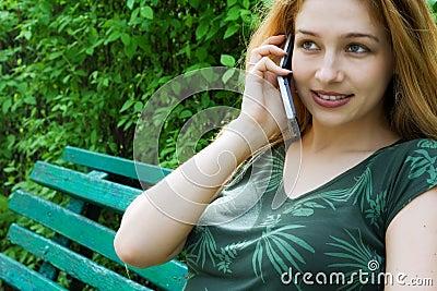 Beautiful girl talking at mobile phone