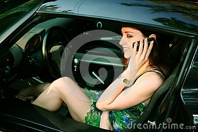Beautiful girl is talking on telephone