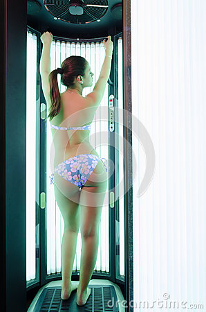 Beautiful girl tanning in the solarium