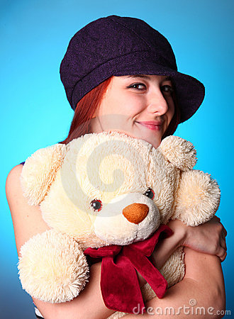 Beautiful girl with teddy bear