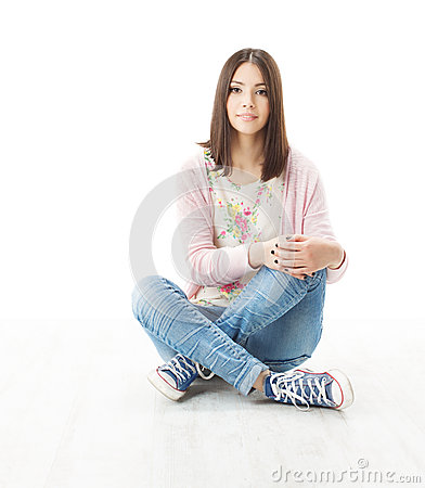 Beautiful girl teenager sitting on floor