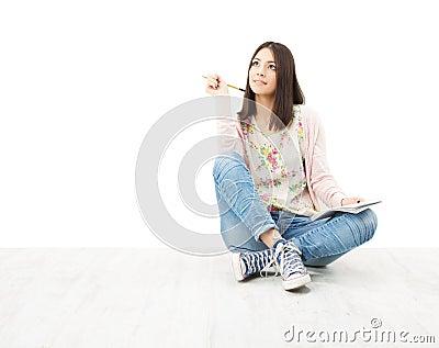 Beautiful girl teenager thinking sitting on floor.