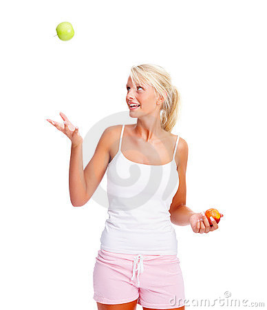 Beautiful girl tossing an apple over white