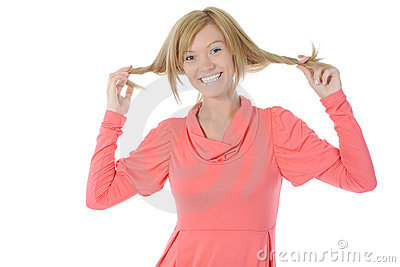 Beautiful girl touches her hair.