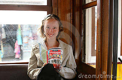 Beautiful girl with a travel guide